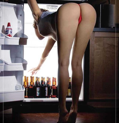 girl in thong getting beer from refrigerator