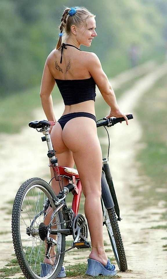 Tight ass girl wearing black thong and stradling bicycle