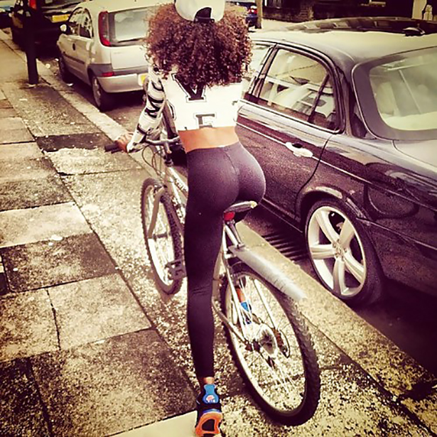 Girl wearing tight yoga pants riding bicycle