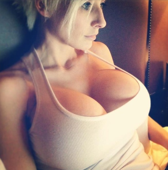 Hot girl with big boobs wearing white tank top