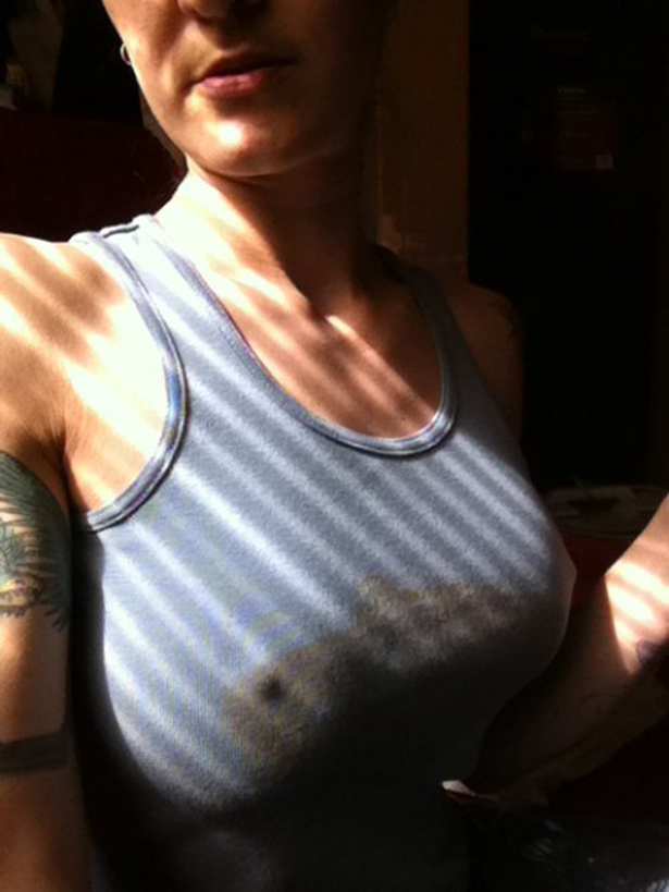 Hot girl with big boobs wearing blue tank top