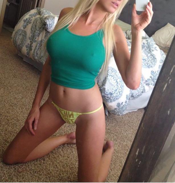 Hot girl with big boobs wearing green tank top