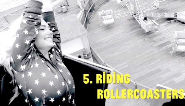 Kate Upton riding a roller coaster