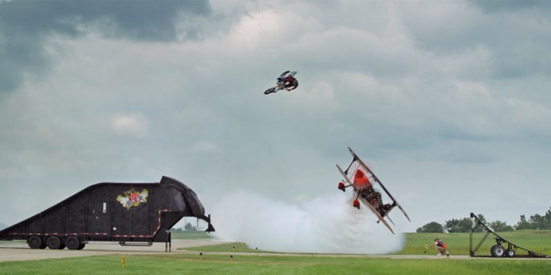Motorcyclist Jumps Flying Biplane. And It's Spectacular.