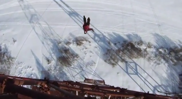 Russian skydiver base jumping off 120m tower